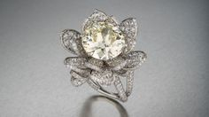 MUNNU The Gem Palace's platinum Lotus Flower Ring showcases an 11.04-carat center diamond and 5.02 total carats of additional #diamonds. Courtesy MUNNU The Gem Palace. Photo by Robert Weldon/GIA.