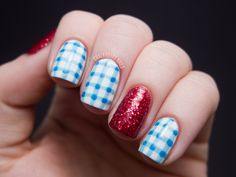 """I decided to put my nails in costume this Halloween and dress them as Dorothy from 'The Wizard of Oz.' The gingham was made using two shades of blue: What's With the Cattitude by OPI and Sky High-Top by China Glaze. The red glitter is Rockin' Rubies by Wet n Wild and I think it really pops on the accent nails."" - Sarah of Chalkboard Nails"