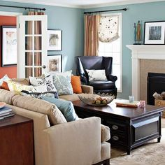 I really like blue walls.  Multifunction furnishings cater to a family room that plays and works hard. Just behind the sofa, an attractive apothecary cabinet provides generous storage for board games, school or craft supplies, and books. The surface holds a table lamp and reading materials. Anchoring the large sectional, a coffee table discreetly multitasks as a snack counter and blanket bin…