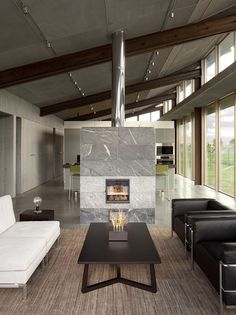 Modern fireplaces are so much more efficient than they used to be so they are no longer relegated to an outside wall where they can get an air draw without