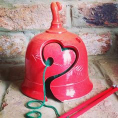 Earth Wool & Fire Yarn Bell with Heart cut out design.