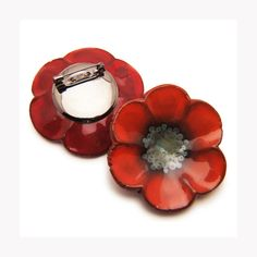 Toronto ceramic artist Julie Moon's poppy pins are now available at the Shop at AGH and the AGH Annex.