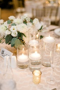 Blush and white wedding reception floral centerpiece with votives for a romantic, candlelit feel! Wedding Table Centerpieces, Floral Centerpieces, Reception Decorations, August Wedding, Our Wedding, Wedding Reception, Dream Wedding, Floral Wedding, Wedding Colors