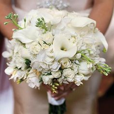 Lush Formal Bouquet | This bridal bouquet features calla lilies, lisianthus, hydrangeas, and roses. | SouthernLiving.com