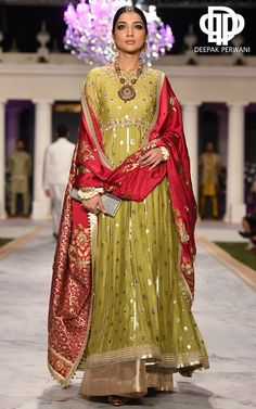 A classic anarkali silhouette in a hand woven tile jacquard fabric. The piece is extensively hand crafted with gota and zardoze on the panels, sleeves [. Pakistani Wedding Outfits, Pakistani Bridal Dresses, Indian Dresses, Indian Outfits, Latest Wedding Dresses Indian, Punjabi Wedding, Designer Suits For Wedding, Indian Designer Suits, Kurta Designs