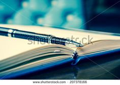 Black pen on the open diary, vintage green tone - stock photo