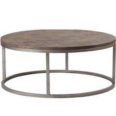 """The Gabby Furniture Edwin coffee table delivers eclectic, rustic style to living rooms. Industrial style reclaimed wood creates a clover-shaped top sitting on an iron base. 38""""W x 38""""D x 16""""H. Recycled pine top with rusty black iron base. Due to the handmade artistry of Gabby's collection, variation between individual products should be expected."""