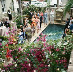 Cocktail Hour around a pool!  Race + Religious has jaw-dropping views around every corner. Photo by A Bryan Photo    #raceandreligious #neworleanswedding #destinationwedding #weddingvenue #neworleansvenue #uniqueweddingvenue