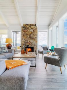 beach retreat meets mid-century modern style - loving the arced wing back chairs + sweeping ocean views