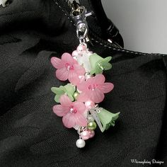"Petal Pink Green Floral Crystal Pearl Cluster Silver Handbag Charm Keychain Accessory is handmade with a silver finish chain, dainty decorative silver finish components and a swivel clasp. Clusters of pink, white and green glass pearls, white acrylic leaves and acrylic flowers in pretty petal pink and green are accented with glass seed beads and sparkling Swarovski crystals in rose and peridot. 4½"" length. Every handbag charm keychain crafted by Whimsydaisy Designs arrives packaged in a…"