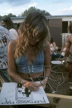 Stevie Nicks signing Fleetwood Mac's self titled 1975 album.