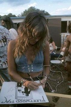 Stevie Nicks signing Fleetwood Mac's self titled 1975 album.