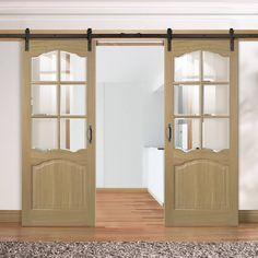 Thruslide Traditional Riviera Oak Sliding Double Door - Bevelled Clear Glass - Prefinished - Lifestyle Image.    #louis #doors