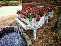 Piano repurposed into waterfall flowerbed - wow!!
