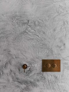 Concrete wall with copper fixtures. Queens Park House by Alexander & Co