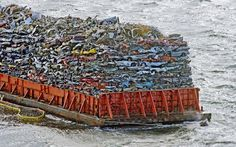 A barge laden with scrap car hulks is anchored in Commencement Bay, Tacoma, Washington, America. On Sunday it was listing and lost some of the cars into the waters of Puget Sound, but is level again. Picture: ZUMA / Rex Features