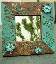 brown and turquoise frame - could paint my gold one like this..
