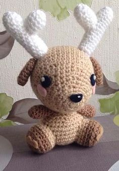 This deer is designed by Eden Dintsikos. It's a free PDF download on Ravelry.