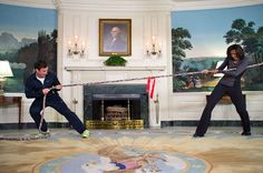 """First Lady Michelle Obama participates in a tug of war with Jimmy Fallon in the Diplomatic Reception Room of the White House during a ŇLate Night with Jimmy FallonÓ taping for the second anniversary of the """"LetŐs Move!"""" initiative, Jan. 25, 2012. (Official White House Photo by Chuck Kennedy)  This official White House photograph is being made available only for publication by news organizations and/or for personal use printing by the subject(s) of the photograph. The photograph may not be…"""