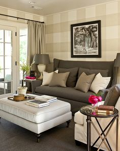 Suzie: Southern Living - tan gingham patterned walls, charcoal gray wingback slipcover sofa, ...