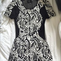 ❕Black and white NASTYGAL dress Tight black and white dress from NASTYGAL. Only been worn once!! Back had sheer black material! Nasty Gal Dresses Mini