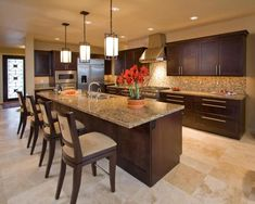 Love this tile floor! Like the counter top and the back splash with the dark cabinets