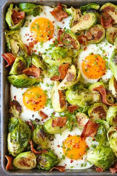 Brussels Sprouts, Eggs and Bacon -  A complete sheet pan breakfast with eggs, crisp bacon and roasted brussels sprouts! Quick/easy with one pan to clean!