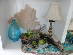 local driftwood, seaglass and succulents
