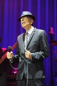 Leonard Cohen Photos Photos - Leonard Cohen performing at the o2 Arena in London. - Leonard Cohen Performs in London