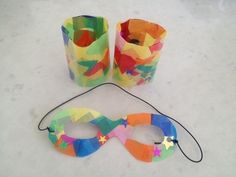 Easy superhero mask and cuffs with contact paper and tissue paper squares