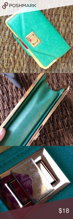 ‼️CLEAROUT! Sea Foam Clutch Beautiful little expandable clutch purchased from a boutique called Wolfgang in Gainesville, FL. Vibrant, sea foam green color with shiny gold accents. I'm not quite sure if it's real leather or not, but it sure feels real. Light scratches on gold turn lock (barely visible unless studying closely..see 3rd pic) Long, detachable dainty gold chain if you'd like to wear it on your shoulder.. Zipper pocket inside. Used once. Chic, adorable, perfect for any occasion. 6…
