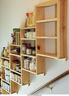 Pantry shelves over the basement garage stairs. I could really use these instead of a row of stuff going down my basement stairs. Stairway Storage, Basement Storage, Ikea Storage, Storage Spaces, Storage Ideas, Hidden Storage, Garage Storage, Stair Shelves, Spice Storage