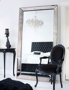 bedroom decor. that black headboard! the chandelier! i love it :)