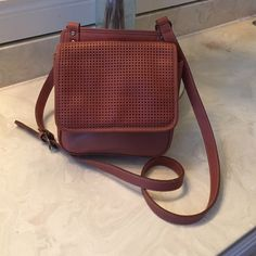 """Perry Ellis Portfolio leather crossbody Vintage. Very cute small cross body. Hardly used and in great condition. The front flap has beat idyl cutout detail. Brass color trims. The inside is very clean. 7""""H x 8"""" W.  Depth 2 1/4"""" Back panel is 8 1/2""""H x 8""""W.  Strap drop 23"""". The last pic is more accurate color. Perry Ellis Bags Crossbody Bags"""