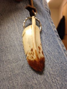A feather carved from a deer antler