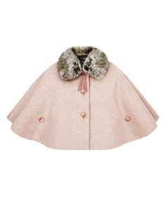 Our charming Claire sparkly tweed cape for baby girls is crafted with a detachable faux fur collar and a velvet bow, and has large button fastenings on the front for secure fit.