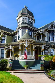 Green and white double-winged Victorian mansion in Alameda, California #victorianarchitecture
