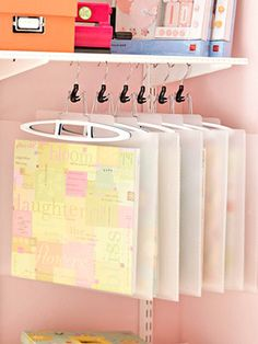 Love this idea! Store scrapbooking/card projects in clear envelopes on hangers.