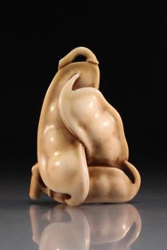 Greatly crafted, slightly stained Japanese carved netsuke figure, depicting three inter-wined green peas, artist's signature to the rear, late 19th/early 20th Century period. Size; Length of carving is 2 inches.