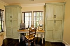 Cabinets banking a window and a desk with natural light! I also like the relaxing colors!