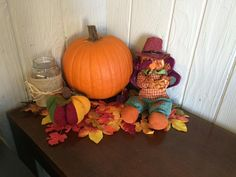 Fall Harvest Decoration pumpkins plush turkey mixed in with fall foliage and a burlap wrapped mason jar