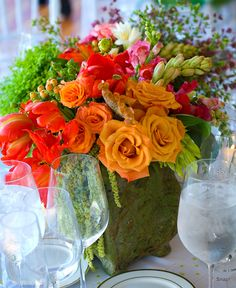 Love the spring colors. Stoneblossom Florals' Centerpieces
