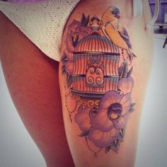 Beautiful delicate bird and cage tattoo