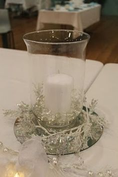 winter wedding ideas- minus the branches and with a little silver & gold in the glass beads & votives around