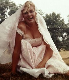 Is DOES look like a wedding dress! Finally got this uploaded ~ what I would GIVE to have hi-speed internet in my neck of the woods - only dial-up is available to me at this point.  Ah the joys of country living... But anyhow ~ Marilyn as a bride ~ what a beautiful pic and a beautiful smile and a beautiful everything!!