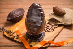 An impressive and unique take on the classic Easter egg. These sculpture-like eggs stand 200 mm tall, and can take 18 of our chocolates. They are made of high quality 75% single origin Tanzanian dark chocolate.Decorative and delicious gift on its own, even more lovely when filled with chocolates. A small amount of gold or silver shimmer may be applied to the finishing.Size: 200 x 135 mm, Min. weight of egg 320 gDairy free, suitable for VegansSending this as a gift for someone? Please use…