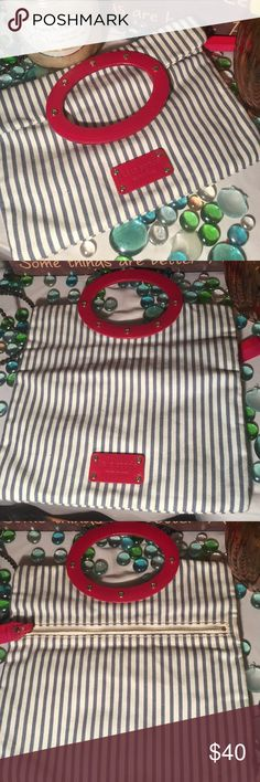 Kate Spade Clutch Authentic Kate Spade Clutch Sz 10x11- Striped blue/white- Canvass material- Clean interior- Rear zipper pocket- In good condition- (1) red Wooden handle- Very nice! kate spade Bags Clutches & Wristlets