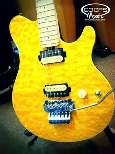 Sterling AX40 Electric Guitar in transparent gold at GoDpsMusic.com