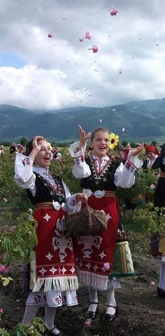 Europe | Two girls wearing traditional clothes, Rose Festival, Kazanlak, Bulgaria