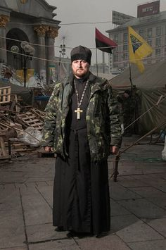 Stunning Portraits Of The Ukraines Maidan Protesters - A priest of the Orthodox Ukrainian Church from St. Nicholas parish in Kiev. In early December he was drawn to the people gathering in the main square to protest and fight.